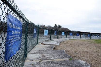 View of 10 banners on fence, Mill Park, Augusta, ME